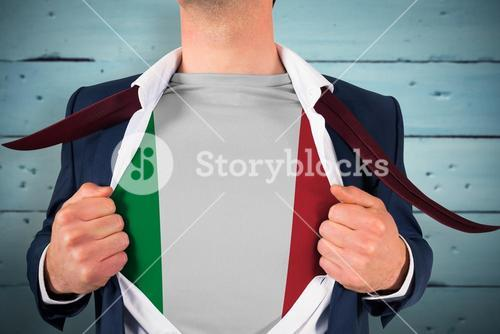 Composite image of businessman opening shirt to reveal italy flag