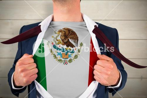 Composite image of businessman opening shirt to reveal mexico flag