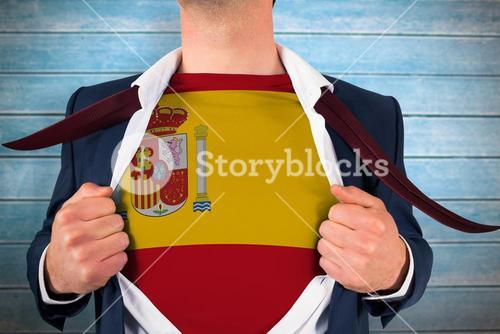 Composite image of businessman opening shirt to reveal spain flag