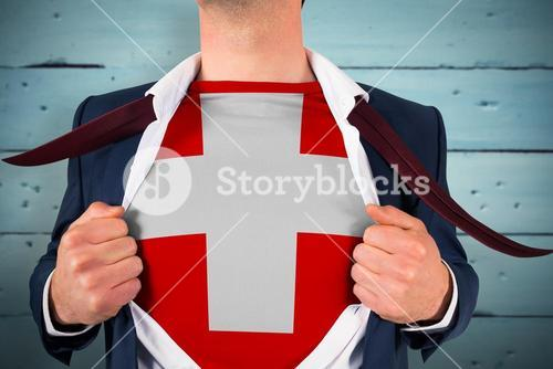 Composite image of businessman opening shirt to reveal swiss flag