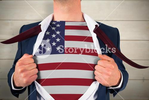 Composite image of businessman opening shirt to reveal usa flag
