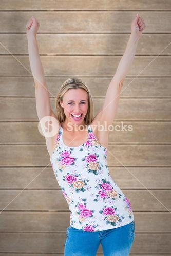 Composite image of happy blonde cheering with arms up