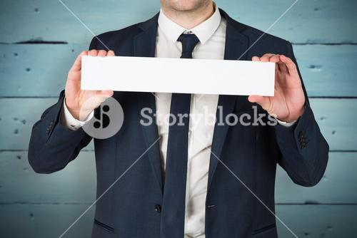 Composite image of businessman showing card to camera