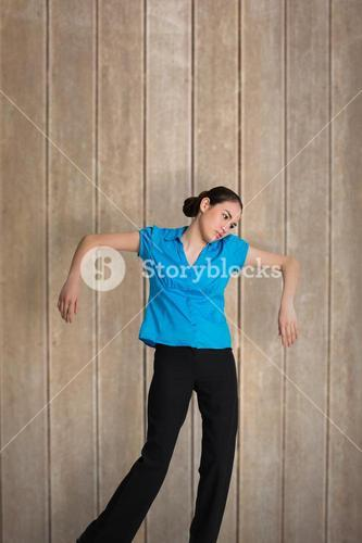 Composite image of young businesswoman hanging like a puppet