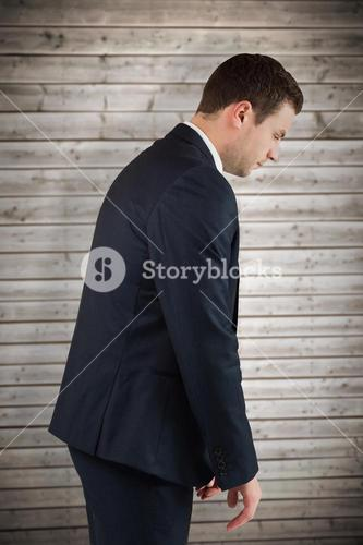 Composite image of businessman bowing