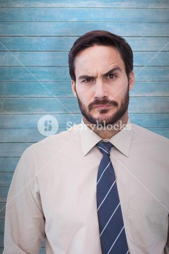 Composite image of portrait of a doubtful young businessman