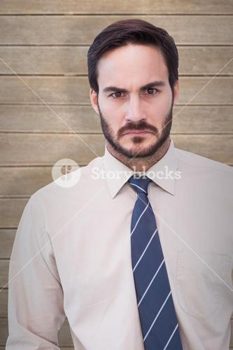 Composite image of portrait of an angry businessman