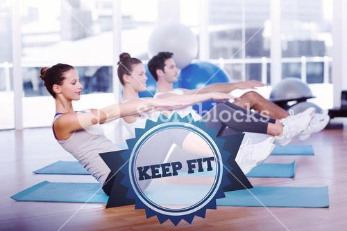 The word keep fit and class stretching on mats at yoga class