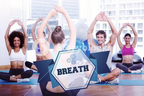 The word breath and people with trainer doing stretching exercises