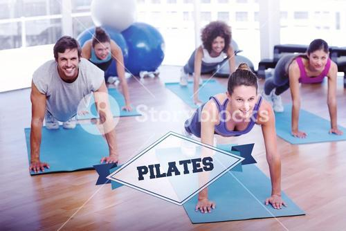 The word pilates and people doing push ups in fitness studio