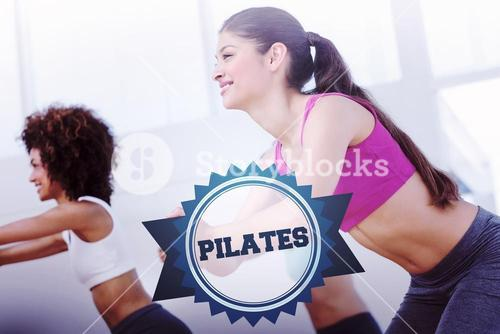 The word pilates and cheerful fitness class