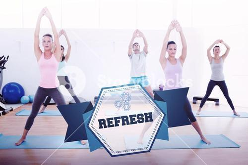 The word refresh and sporty class doing pilate exercises