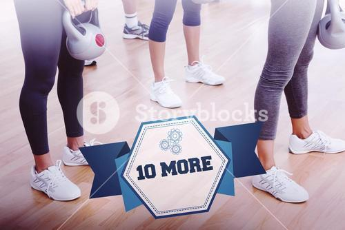 The word 10 more and fit women exercising with kettlebells