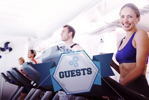 The word guests and row of people working out on treadmills