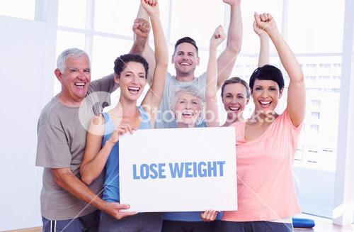 Lose weight against portrait of happy fit people holding blank board