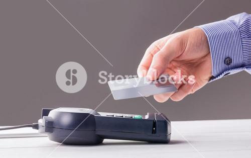 Man using card to express pay
