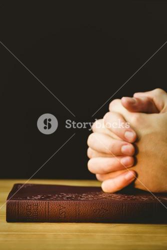 Man praying with his bible