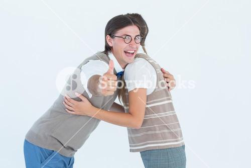 Geeky hipster couple hugging