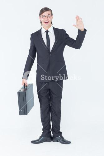 Geeky businessman waving at camera