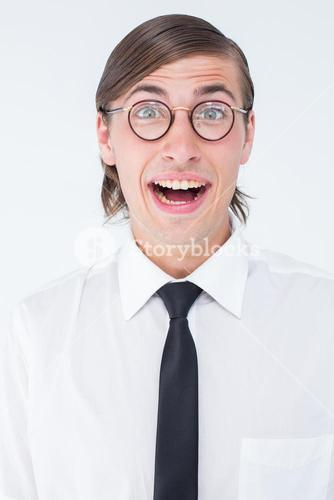 Geeky businessman smiling at camera