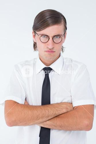Geeky businessman looking at camera with arms crossed
