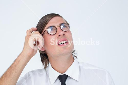 Thoughtful geeky businessman scratching his head