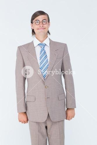Geeky businessman looking at camera