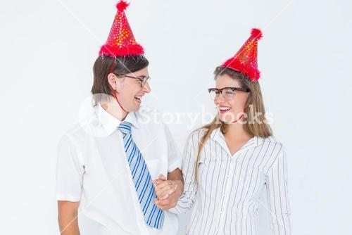 Happy geeky hipster couple with party hat