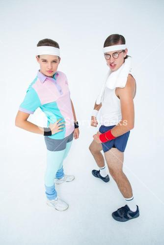 Geeky hipster couple posing in sportswear