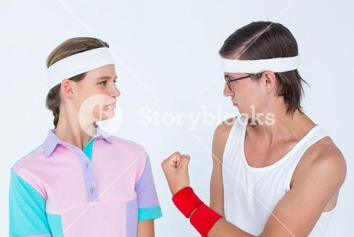 Geeky hipster showing fist to his girlfriend