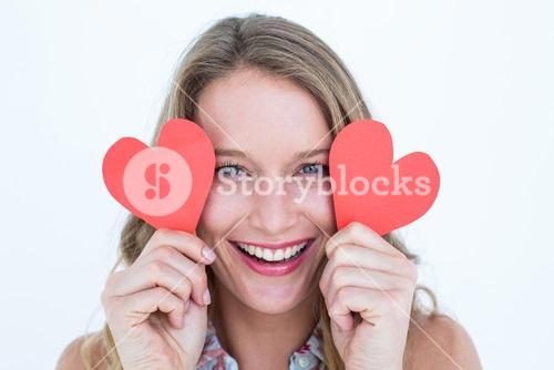 Woman holding heart cards