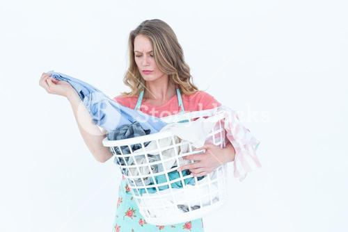 Woman looking at dirty clothes