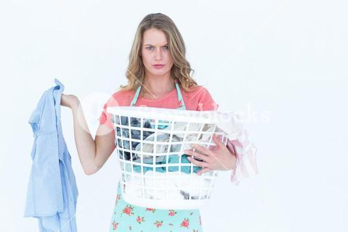 Woman holding dirty clothes