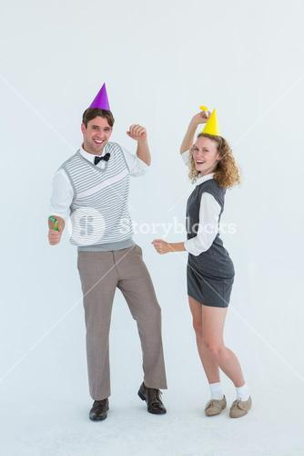 Geeky couple dancing with party hat