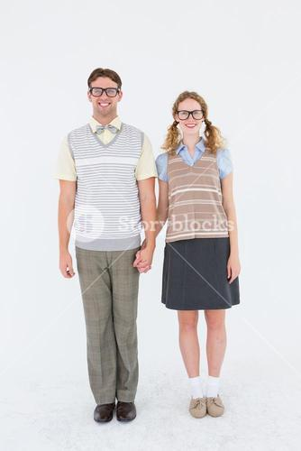 Smiling geeky hipster couple holding hands