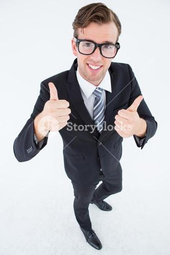 Geeky hipster smiling at camera with thumbs up