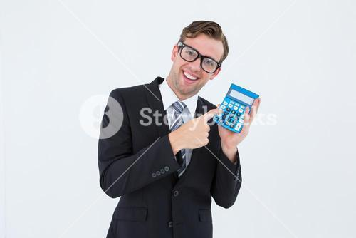 Geeky businessman pointing to calculator
