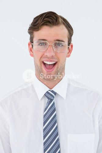 Happy geeky businessman looking at camera