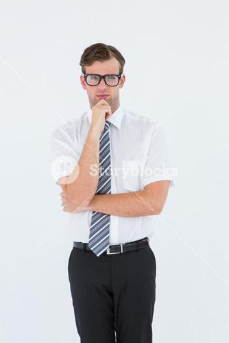 Serious geeky businessman thinking and holding his chin