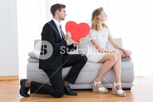 Businessman giving heart card to his girlfriend