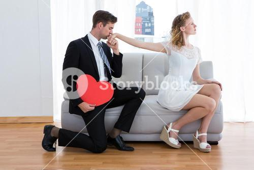 Businessman kissing his girlfriend hand