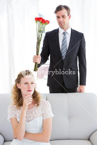 Happy businessman giving roses to his girlfriend