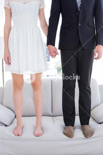 Couple standing on the couch