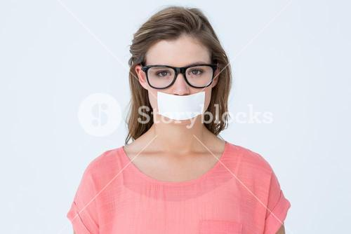 Geeky hipster with adhesive tape on mouth