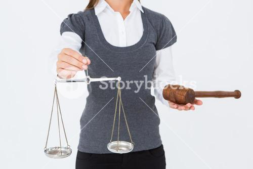 Woman holding a gavel and scales of justice