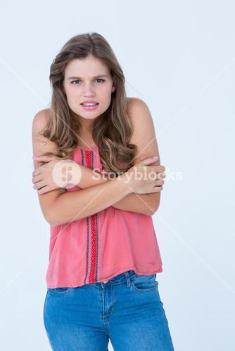 Shivering woman holding her arms