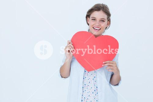 Woman holding heart card