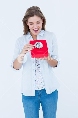 Happy woman opening a present