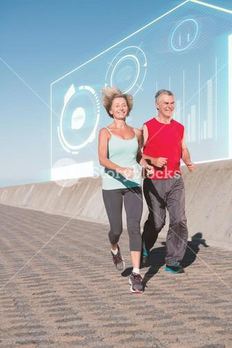Composite image of active senior couple out for a jog
