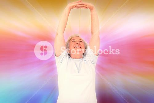 Composite image of senior woman stretching her arms